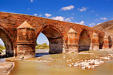 cobandede bridge over the Aras River (aka Araks, Arax, Araxi, Araxes, Araz, or Yeraskh) on the Silk Road from Erzurum to Kars, masterpiece of the Seldjuks, Anatolia, Turkey