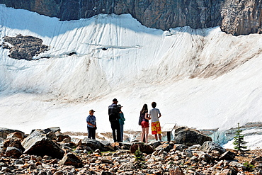 Tourists looking at Cavell Lake from high viewpoint, Jasper National Park, Alberta, Canada.