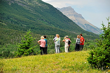 Tourists observing nature, Waterton Lakes National Park, Alberta, Canada.