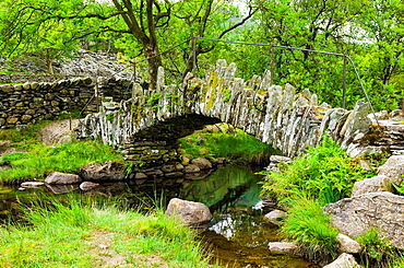 A stone footbridge over the River Brathay near Little Langdale in the Lake District, Cumbria, England.