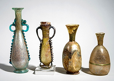 Decorated Roman Glass amphoras and bottles 3-4th century CE.