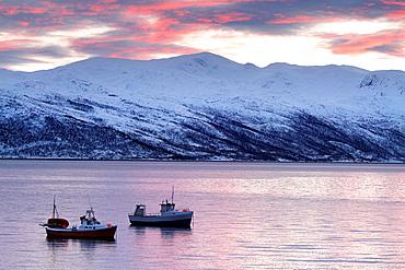 Fishing boats in norwegian fjords.