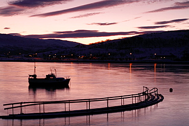 Sunrise in Kvaloyvagen, a fishing village near Tromso, in norwegian fjords.