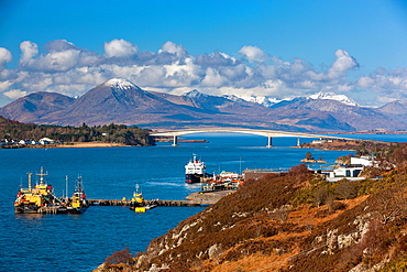 A view towards the Skye Bridge over Loch Alsh, connecting mainland Highland with the Isle of Skye. It forms part of the A87. One pillar of the bridge stands on the island of Eilean Ba†n, Kyle of Lochalsh, Highland, Scotland, UK, Europe.