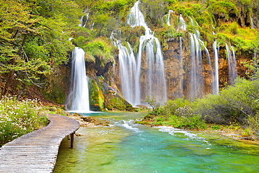 Croatia, wooden paths and waterfalls with water cascades in Plitvice Lakes National Park central Croatia, UNESCO.
