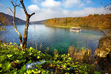 Croatia, autumn landscape of Plitvice Lakes National Park, electric power ferry boat on the lake, Plitvice, central Croatia.