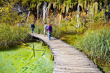 Croatia, Plitvice Lakes National Park, tourist on the wooden paths, central Croatia.