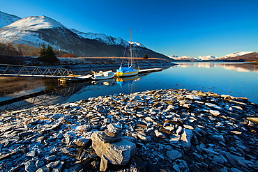 Scotland, Scottish Highlands, Ballachulish. Sailing boats moored on Loch Leven, looking towards Beinn Bhan, Sgorr Bhan and Sgorr Dhearg.