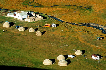 Yurts in a meadow, Tash Rabat, Kyrgyzstan, Central Asia.