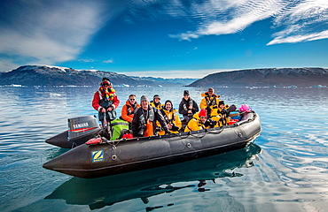Tourist on Zodiacs exploring and photographing Icebergs, Scoresbysund, Greenland.