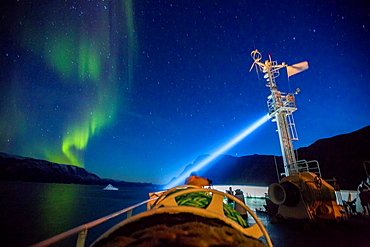 Aurora Borealis seen from a cruise ship, Scoresbysund, Greenland. The Akademik Sergey Vavilov-Russian research vessel built in 1988 currently used as a cruise ship.
