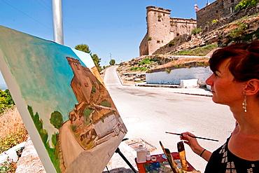 Painter paint a castle of Sabiote, Jaen, Spain