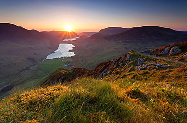 A view of Buttermere at sunset, from the summit of Fleetwith Pike in the Lake District.
