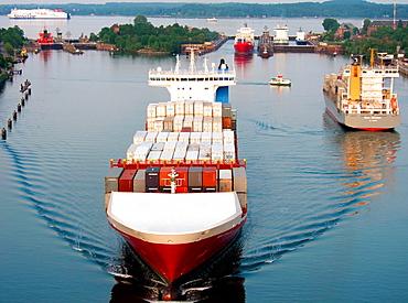 Container ship, the Kiel Canal, Holtenau, Kiel, Kiel Fith, the Baltic Sea, Schleswig-Holstein, Germany, Europe.