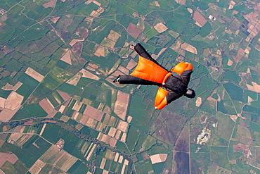 Man wingsuit flying over Empuriabrava, Spain