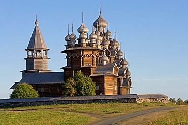 Church of the Intercession of the Mother of God, Pokrovskaia Tserkov, 1764, Church of Transfiguration, Preobrajenskaia Tserkov, 1714, Tower clock, 1874, Kizhi Island, Onega lake, Karelia, Russia.