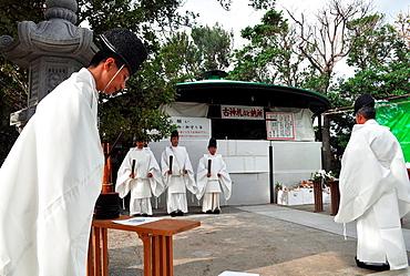 Naha, Okinawa, Japan, Shinto priests during the burning Shimenawa ropeís ceremony at Naminoue Shrine