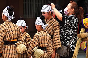 Naha, Okinawa, Japan, girls getting dressed before a traditional Okinawan dancing show in Tsuboya neighborhood