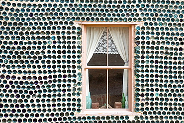 Beatty, Nevada, The bottle house in Rhyolite, a town that boomed for a few years after gold was discovered in 1904. Tom Kelly built the house in 1906 from thousands of discarded beer and liquor bottles. It was repaired in 1925 and 2005.