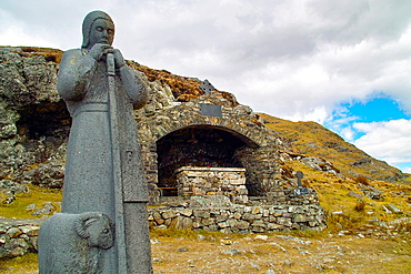 Statue of St. Patrick, Ireland's patron saint, and an Altar, at Maumeen pass, Maamturk Mountains, County Galway, Ireland. Every year pilgrims climb to this location for mass and stations of the cross, celebrated here.