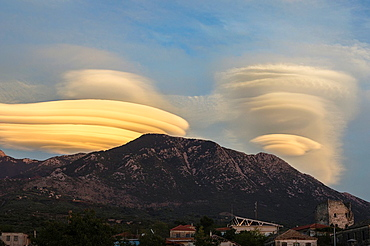 Lenticular clouds forming at sunset over the Taygetus mountains, in the Outer Mani, Peloponnese, Greece.