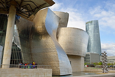 Guggenheim museum and Iberdrola Tower at foreground, Bilbao, Biscay, Basque Country, Spain.