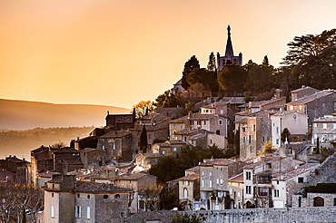 Europe, France, Vaucluse, Luberon. The perched village of Bonnieux at dusk.