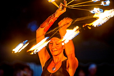 Europe, France, Fayence, Var. Medieval Festival. Performance with a flaming wheel.