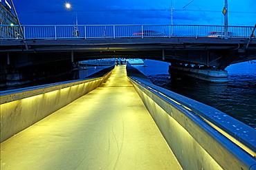 Pedestrian Passage Under Mont Blanc Bridge On Rhone River, At Night, Geneva, Switzerland.