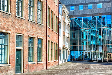 detail view of architecture in The Hague with reflections of old buildings in a new building.