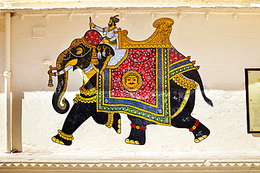 Elephant art painting on the wall of the Udaipur City Palace, Udaipur, Rajasthan, India.
