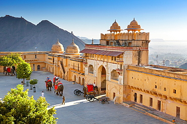 Amber Fort, elephants on the Jaleb Chowk courtyard and main gate of Amber Fort, Jaipur, Rajasthan, India.