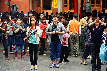 Locals and tourists come to ask for blessings at the Hsingtian Temple.