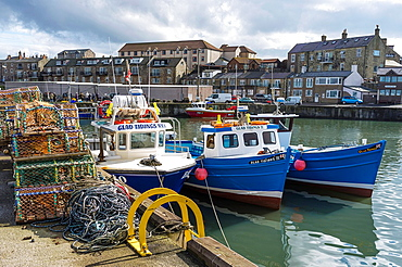 Harbour with fishing and tourist boats, Seahouses, Northumberland, England, Great Britain.