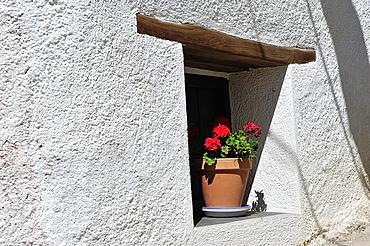 Geraniums in the window. Mecina-Fondales, Las Alpujarras. Granada, Spain