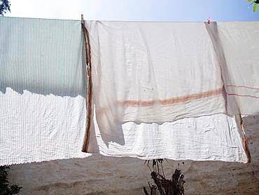 Laundry hangs on a line in Bangalore, Karnataka, India.