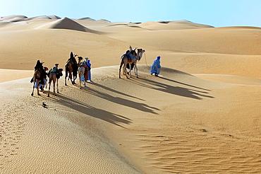 Tuaregs riding Camels, Tuareg Caravan, Libyan Arab Jamahiriya, Libyan Desert.