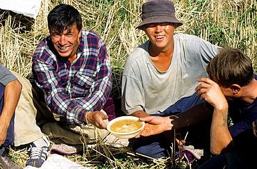 Issyk Kul Lake, Field Worker have lunch, Kyrgyzstan.