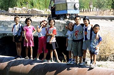 Jala Abad, Kyrgyzstan, Kids on a big tube.