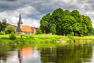Picturesque little church of Wahmbeck and Weser river, Lower Saxony, Germany, Europe