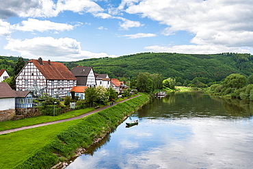 Weser river and the picturesque town of Gieselwerder, Hesse, Germany, Europe