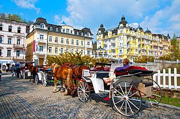 Horse drawn carriages in Spa Gardens park Marianske Lazne aka Marienbad spa town Karlovy vary region Czech Republic Europe.