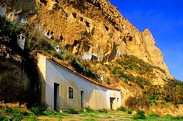 Cave houses at Terrera del Calguerin troglodyte quarter.Cuevas de Almanzora, Almeria province, Andalucia, Spain.