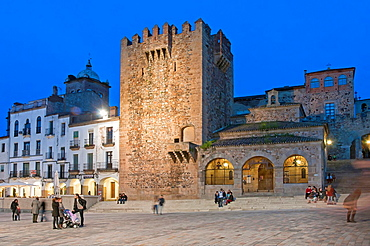 Main Square, Bujaco tower -12th century and Hermitage of the Peace -18th century, Caceres, Region of Extremadura, Spain.