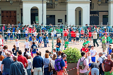 Children playing volleyball in the centre of Turin on a Sunday moring.