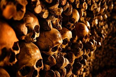 Human Skulls and bones in the wall of the Skull Chapel (Kaplica Czaszek) in Czermna, Poland.