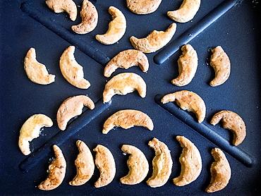 Small Half Moon shaped Greek Cookies, Koulourakia, on Baking Tray.