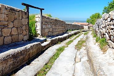 Deep rut in the road, Cufut Qale, Chufut-Kale Jewish Fortress Crimea, Ukraine, Eastern Europe.