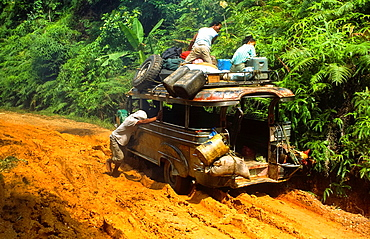 jeepney on dirtroad in the jungle of Palawan, Philipines