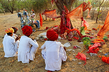 India, Rajasthan, Meda village around Jodhpur, Rabari ethnic group, prayer at Mata Mandir (Mother temple).